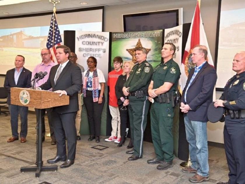 DeSantis speaks with authorities. (News Service Florida photo)
