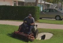 Gardner cuts the grass on the lawn. (WINK News photo)
