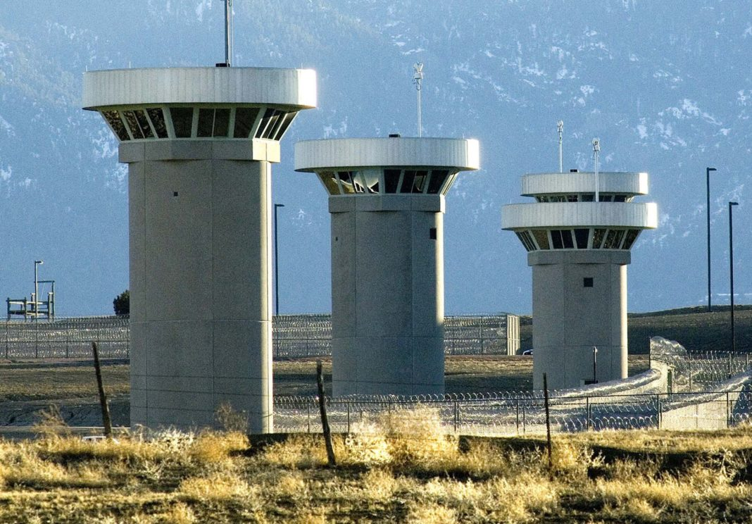 FILE - In this Feb. 21, 2007, file photo, guard towers loom over the administrative maximum security federal prison called Supermax near Florence, Colo. Experts say the drug lord Joaquin