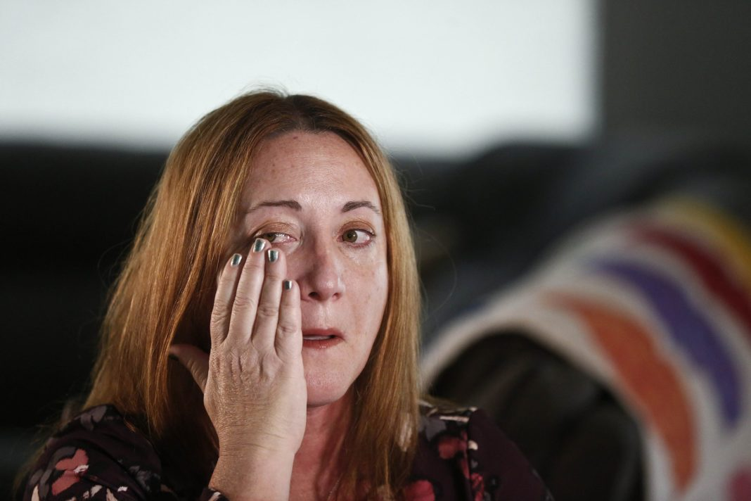 Lori Alhadeff, mother of 14-year-old Alyssa Alhadeff who was one of 17 people killed at Marjory Stoneman Douglas High School, wipes away a tear as she cries while talking about her daughter on Wednesday, Jan. 30, 2019, in Parkland, Fla. She and her husband marched with Parkland students in Washington, demanding gun control. And in May, she was elected to the school board. (AP Photo/Brynn Anderson)