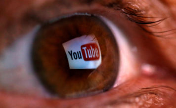 Man views YouTube content. (CBS News photo)