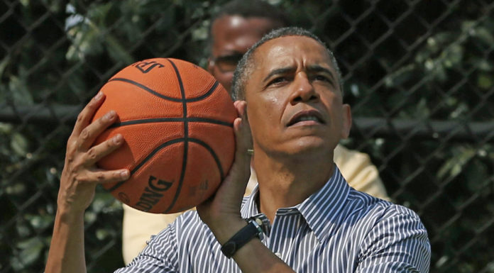 Former President Barack Obama plays basketball. (CBS News photo)