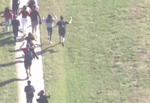 Parkland students flee the school as a mass shooting takes place. (WINK News photo)