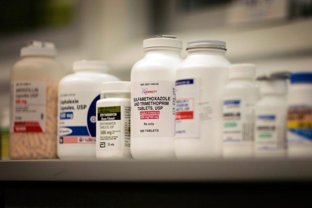 Bottles of medication at a pharmacy. (CBS News photo)