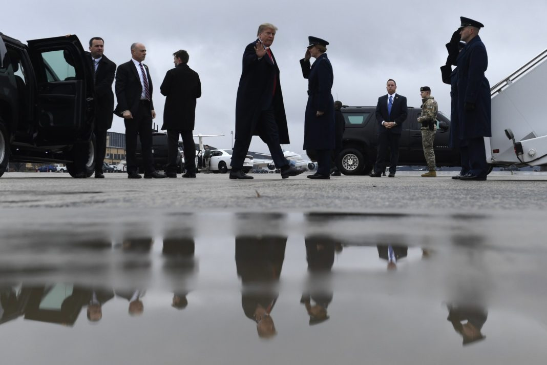 President Donald Trump waves as he arrives to board Air Force One at Andrews Air Force Base in Md., Monday, Feb. 11, 2019. Trump is heading to El Paso, Texas, to try and turn the debate over a wall at the U.S.-Mexico border back to his political advantage as his signature pledge to American voters threatens to become a model of unfulfilled promises. (AP Photo/Susan Walsh)