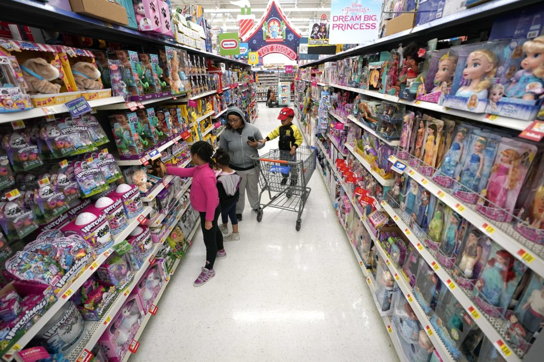 FILE- In this Nov. 9, 2018, file photo shoppers look at toys at a Walmart Supercenter in Houston. Walmart Inc. reports financial results Tuesday, Feb. 19, 2019. (AP Photo/David J. Phillip, File)