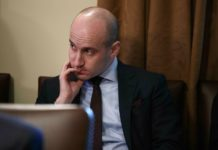 """FILE- In this Jan. 2, 2019, file photo White House senior adviser Stephen Miller listens as President Donald Trump speaks during a cabinet meeting at the White House in Washington. Miller indicated Sunday, Feb. 17, on """"Fox News Sunday"""" that Trump is prepared to issue the first veto of his term if Congress votes to disapprove of his declaration of a national emergency along the U.S.-Mexico border. (AP Photo/Evan Vucci, File)"""