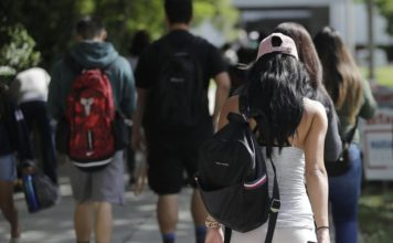 FILE- In this Oct. 23, 2018, file photo, students walk on the campus of Miami Dade College, in Miami. The nine companies and organizations tasked with servicing the accounts of the nation's 30 million student loan borrowers repeatedly failed to do their jobs properly over a period of years and their regulator neglected to hold them responsible, a new report finds. The report released Thursday, Feb. 14, 2019, by the Department of Education's independent Inspector General's office shows some borrowers weren't getting the guidance and protection they needed as they sought the best plan for paying off their student loans. (AP Photo/Lynne Sladky)