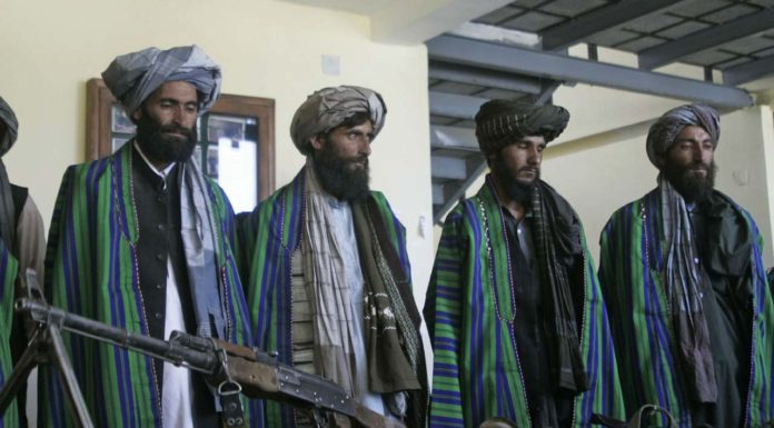 Former Taliban fighters hand over their weapons to Afghan police as part of a reconciliation process in Herat, Afghanistan, Sunday, May 13, 2012. (AP Photo/Hoshang Hashimi)