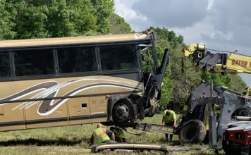 Towing the bus in process. (WINK News photo)