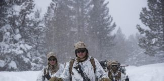 U.S. Marines walk along a snow-covered trail during their advanced cold-weather training at the Marine Corps Mountain Warfare Training Center Sunday, Feb. 10, 2019, in Bridgeport, Calif. After 17 years of war against Taliban and al-Qaida-linked insurgents, the military is shifting its focus to better prepare for great-power competition with Russia and China, and against unpredictable foes such as North Korea and Iran. (AP Photo/Jae C. Hong)