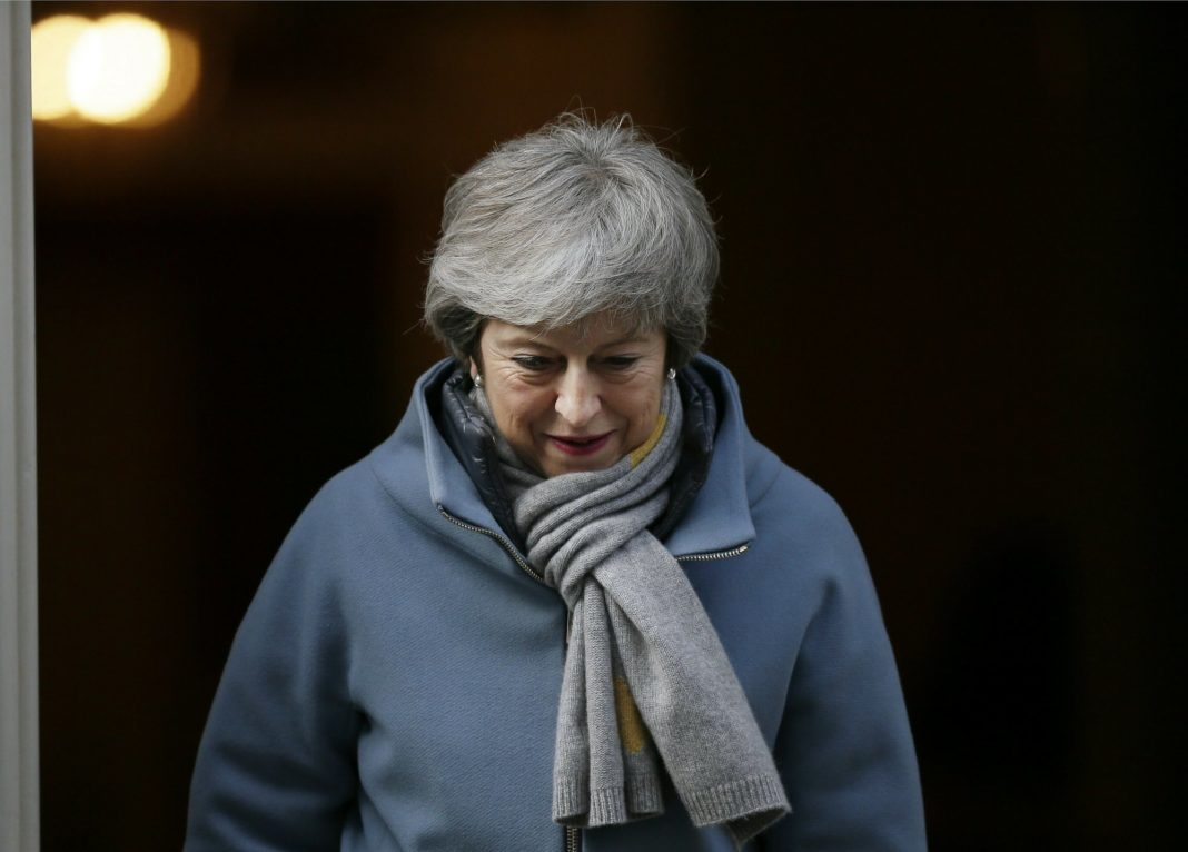 Britain's Prime Minister Theresa May leaves 10 Downing street in London, Thursday, March 14, 2019. British lawmakers faced another tumultuous day Thursday, as Parliament prepared to vote on whether to request a delay to the country's scheduled departure from the European Union and Prime Minister Theresa May struggled to shore up her shattered authority. (AP Photo/Tim Ireland)