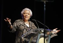 FILE - This May 7, 2018 file photo shows Donna Brazile speaking at the inauguration of New Orleans Mayor Latoya Cantrell in New Orleans. Fox News says it has hired former Democratic National Committee chief Brazile as a political commentator. She had been let go from a similar role at CNN in 2016 after it was revealed that she had shared material about topics that would be addressed at a Democratic forum with Hillary Clinton's campaign. (AP Photo/Gerald Herbert, File)