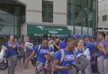 FGCU women's basketball team boards the bus to its first round game against the University of Miami in Coral Gables Friday evening. (Credit: WINK News)