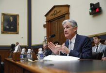 FILE- In this Feb. 27, 2019, file photo Federal Reserve Board Chair Jerome Powell gestures while speaking before the House Committee on Financial Services hearing on Capitol Hill in Washington. The message the Federal Reserve is poised to send on Wednesday, March 20, when its latest policy meeting ends this week is a soothing one. It reflects an abrupt shift in tone since the start of the year in the face of a slowdown in the United States and abroad, persistently tame inflation and a nervous stock market. (AP Photo/Pablo Martinez Monsivais, File)