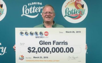 Glen Farris poses with his oversized check after claiming a $2 million prize in the POWERBALL drawing held on March 23, 2019 at Florida Lottery Headquarters. (Credit: Florida Lottery).
