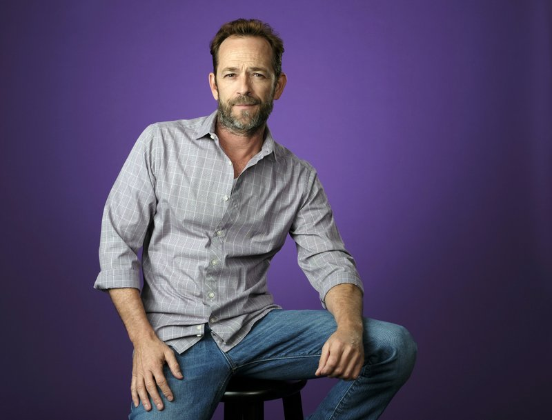 FILE - In this Aug. 6, 2018, file photo, Luke Perry poses for a portrait during the 2018 Television Critics Association Summer Press Tour in Beverly Hills, Calif. A publicist for Perry says the