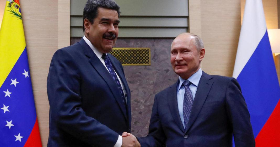 Nicolas Maduro shakes the hand of Vladimir Putin. (Credit: CBS News)