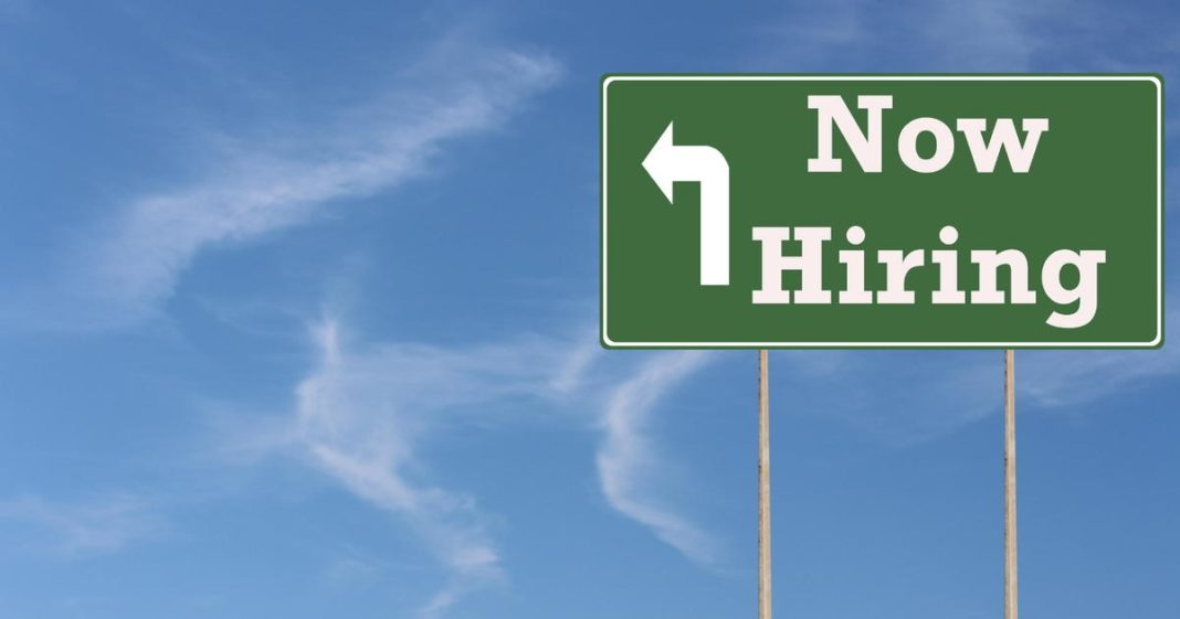 Sign for hiring of new workers. (Credit CBS News)