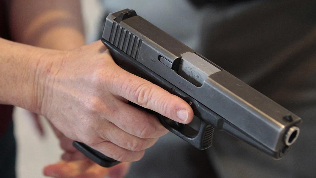 Teacher with a firearm. (Credit: CBS News)