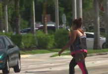 Woman crosses the street illegally. (Credit: WINK News)