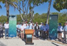 President Mike Martin, surrounded by Florida Gulf Coast University faculty and students, announces the founding of The Water School during a ceremony at FGCU's Vester Field Station in Bonita Springs on Friday, March 22, 2019. (Credit: WINK News)