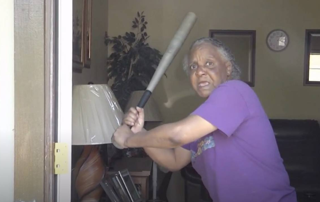 Clarese Gainey, 65, protects herself with a bat. (Credit: CBS)