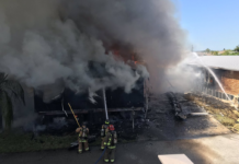 Firefighters battle flames on Windmill Blvd in Punta Gorda. (Credit: Charlotte County Fire & EMS)