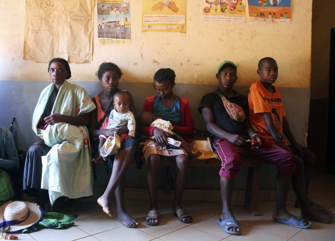 In this photo taken Thursday, March 21, 2019, mothers wait to have their babies vaccinated against measles, at a healthcare center in Larintsena, Madagascar. As the island nation faces its largest measles outbreak in history and cases soar well beyond 115,000, the problem is not centered on whether to vaccinate children. Many parents would like to do so but face immense challenges including the lack of resources and information. (AP Photo/Laetitia Bezain)