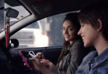 Teen texting while driving. (Credit: NHTSA)