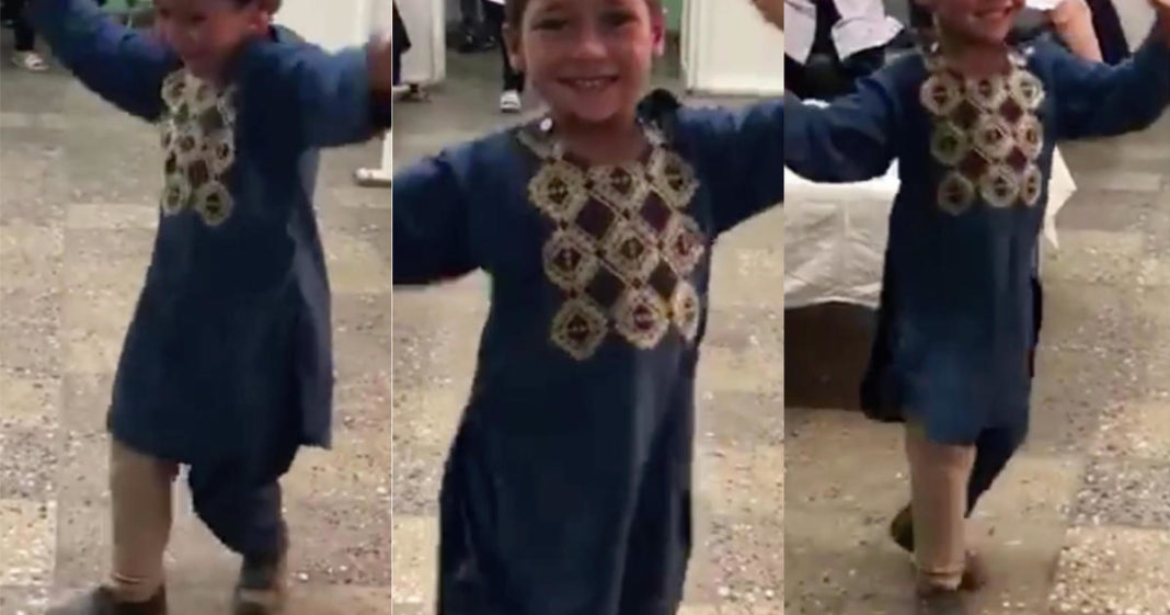 Boy who lost leg from landmine in Afghanistan dances after receiving prosthetic limb. (Credit: CBS News)
