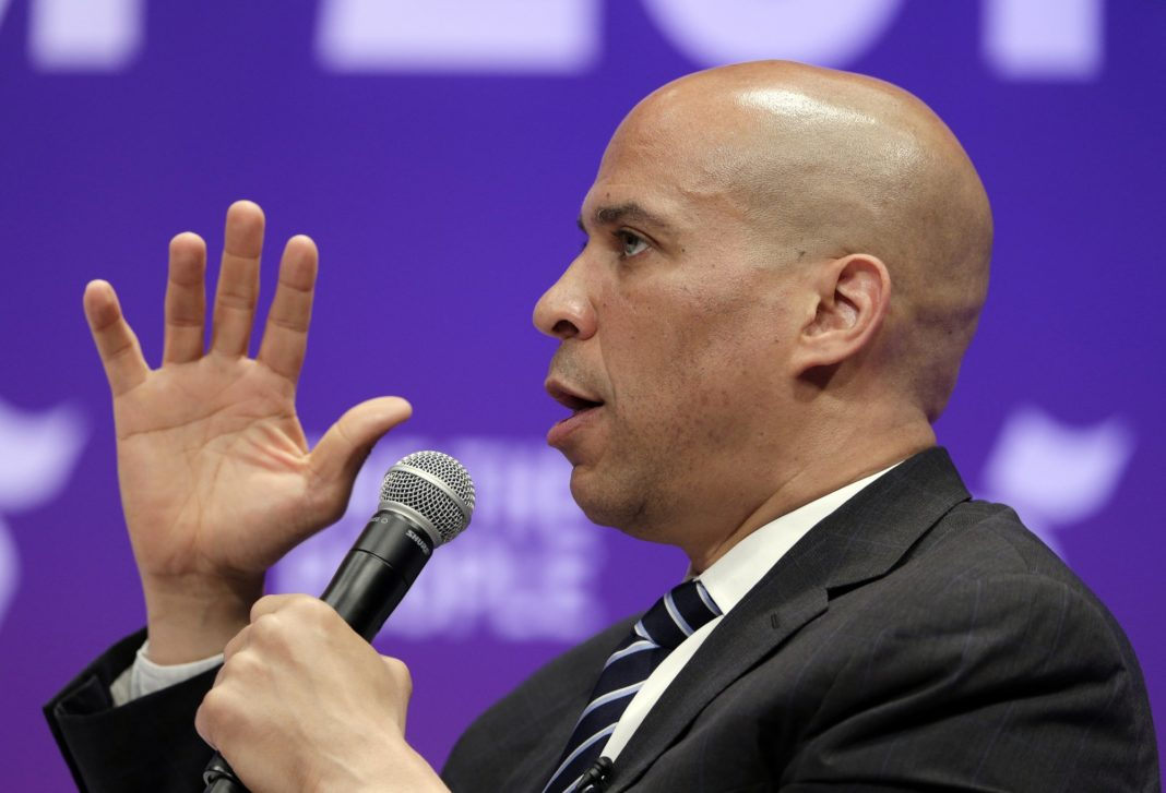 Democratic presidential candidate Sen. Cory Booker, D-N.J., answers questions during a presidential forum held by She The People on the Texas State University campus Wednesday, April 24, 2019, in Houston. (AP Photo/Michael Wyke)