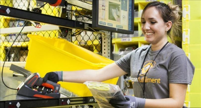 Employee ships items. (Credit: Amazon)