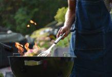 Man grilling meats and vegetables in the park. (Credit: Vincent Keiman Unsplash)