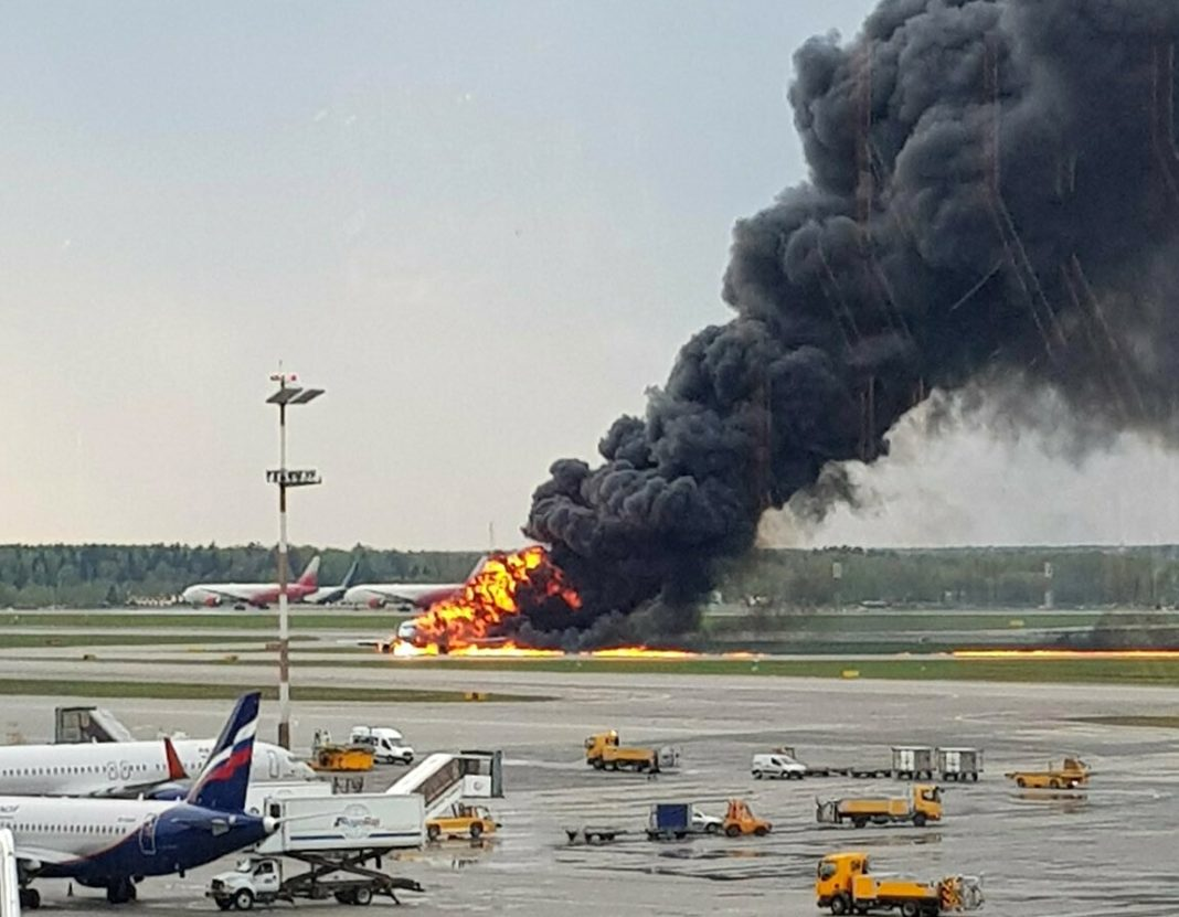 In this image provided by Riccardo Dalla Francesca shows smoke rises from a fire on a plane at Moscow's Sheremetyevo airport on Sunday, May 5, 2019. (Riccardo Dalla Francesca via AP)