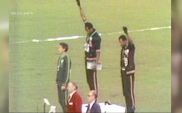 Tommie Smith at the podium. (Credit: Delois Smith)