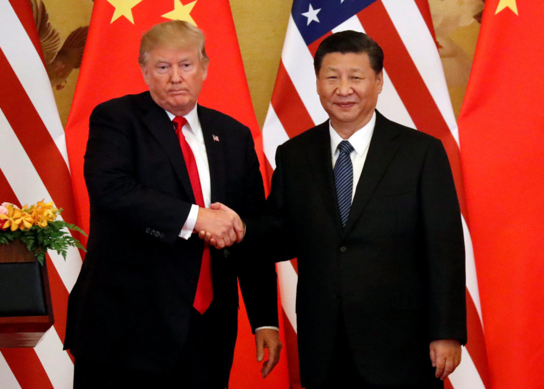 U.S. President Donald Trump and China's President Xi Jinping shake hands. (Credit CBS News)