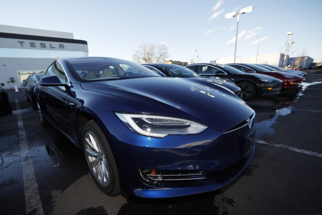 FILE - In this Sunday, Feb. 3, 2019, file photograph, an unsold 2019 S75D sits at a Tesla dealership in Littleton, Colo. Rising trade tensions have sparked worries about the 17 exotic-sounding rare minerals needed for high-tech products like robotics, drones and electric cars. China recently raised tariffs to 25% on rare earth exports to the U.S. and has threatened to halt exports altogether after the Trump administration raised tariffs on Chinese products and blacklisted telecommunications giant Huawei. (AP Photo/David Zalubowski, File)