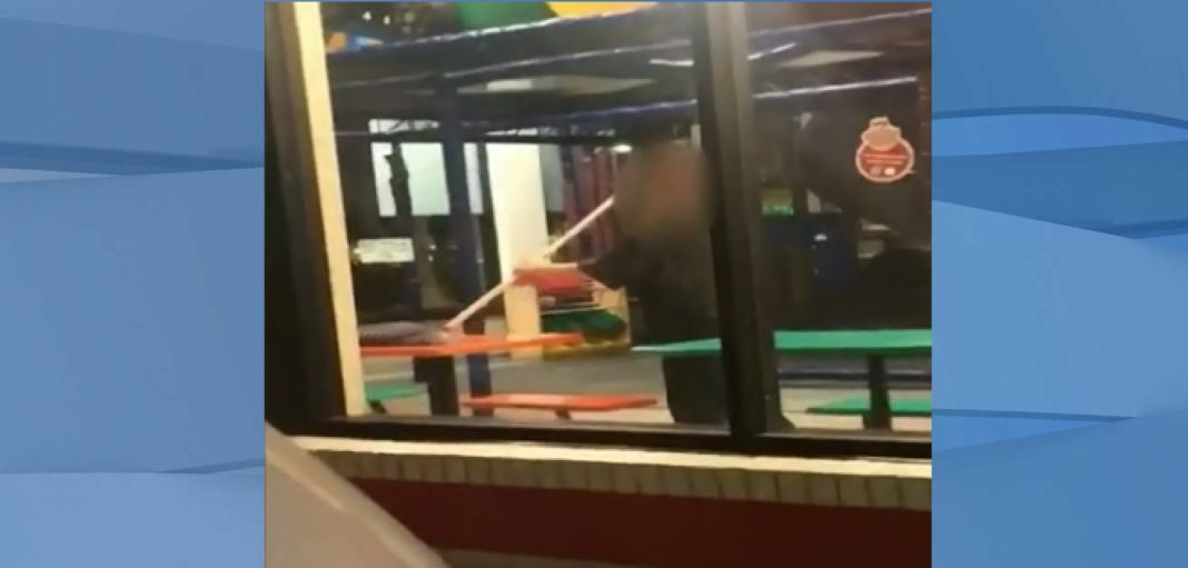 Burger King worker mops up table. (Credit: Katie Duran)
