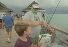 CCSO deputy hangs out with a kid on summer break. (Credit: WINK News)