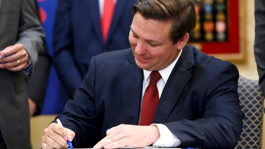 FILE: Gov. Ron DeSantis signs bill banning sanctuary cities in Florida. (Credit: CBS/File)