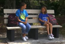Kids sitting on the new concrete bench. (Credit: WINK News)