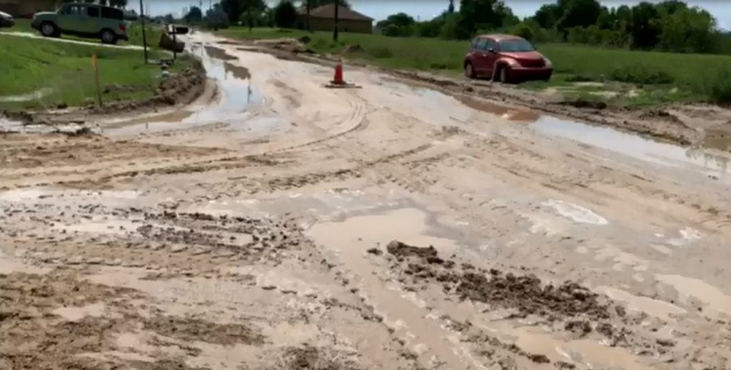 Muddy road leading to problems for some Cape Coral drivers. (Credit: WINK News)