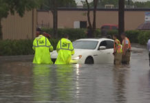Car stuck in the water at Fowler St. in Fort Myers. (Credit: WINK News)