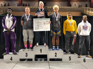 Colby Singletary, 18 years old, stands atop the podium. (Credit: Singletary family)