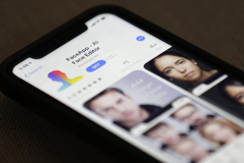 FaceApp is displayed on an iPhone Wednesday, July 17, 2019, in New York. The popular app is under fire for privacy concerns. (AP Photo/Jenny Kane)