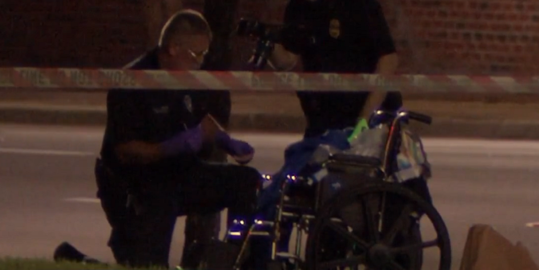 Officer investigating the area around the disabled veteran's wheelchair. (Credit: CBS)