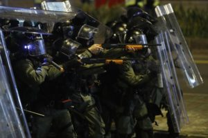 Riot police officer point weapons during confrontation with protesters in Hong Kong on Sunday, July 21, 2019. (AP Photo/Vincent Yu)
