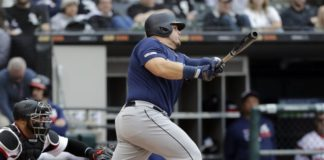 Seattle Mariners' Daniel Vogelbach hits a three-run double against the Chicago White Sox during the third inning of a baseball game in Chicago, Sunday, April 7, 2019. (AP Photo/Nam Y. Huh)