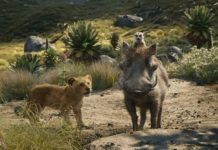 """FILE - This file image released by Disney shows, from left, young Simba, voiced by JD McCrary, Timon, voiced by Billy Eichner, and Pumbaa, voiced by Seth Rogen, in a scene from """"The Lion King."""" The Walt Disney Co. is ruling the box office again with the record-breaking debut of """"The Lion King"""" this weekend. The studio says Sunday, July 21, 2019 that the photorealistic remake devoured an estimated $185 million in ticket sales from 4,725 North American locations. It's a record for the month of July, PG-rated films and the ninth highest opening of all time.(Disney via AP, File)"""